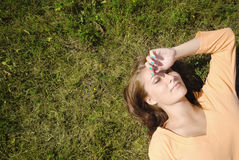 Slleping girl. Girl lying on the grass Royalty Free Stock Photo