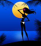 Sllhouette of Young Woman on a Moonlit Beach Stock Photos