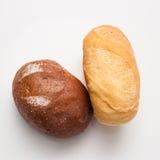 Släntrar av bröd—brunt och vit Arkivfoto