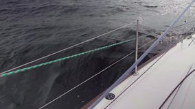 Slow motion view of splash of water. View from yacht sailing yacht board. Slo mo view of splash of water. View from sailing yacht board stock video footage