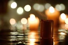 Slocknad stearinljus med reflexion royaltyfri foto