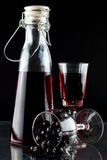 Sloe gin. A close up of home made sloe gin in a stopper bottle royalty free stock photo