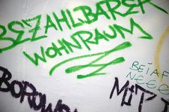 Slogan Affordable housing. The political slogan and the social critique `Affordable housing` on a wall royalty free illustration
