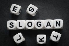 Slogan da palavra em cubos do brinquedo foto de stock