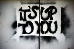 Slogan Its up to you. The political slogan and the call `Its up to you` on a wall stock images