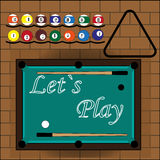 Slogan Let`s play to billiard. Billiard table, billiard balls, two cue, triangle on the brick background Royalty Free Stock Photography