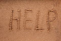 Slogan on a sand. go to beach. A smiley face drawing on a sand Stock Photo
