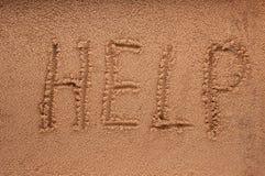 Slogan on a sand. go to beach. Stock Photo