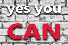 The slogan yes you can on the a brick wall. Design Royalty Free Stock Photo