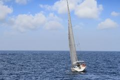Free Sloop Sailboat On A Quiet Sea In Open Waters. Stock Photography - 104368072