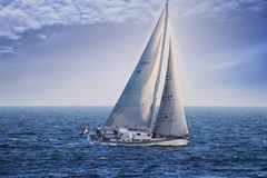 Sloop Sailboat USA 18 Sailing In Open Waters. Stock Image