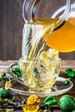 Slop green tea from mug Stock Photos