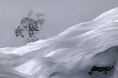 Slope. A slope with skiers, background of a misty peak Stock Images