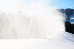 The slope of Bukovel ski resort with working snow machine Stock Photo