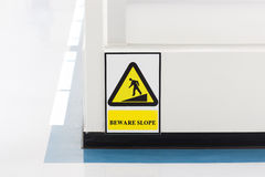 Slope caution board information Stock Photos