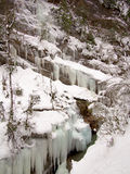Slope covered with icicles Stock Images