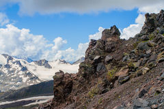 Slope of Elbrus. Stones that have appeared at the gathering of the lava flow along the slope of Mount Elbrus a million years ago Royalty Free Stock Photos