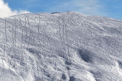 Slope for freeride with traces from skis and snowboards Stock Image