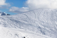 Slope for freeriding with traces from skis, snowboards and blue Stock Photography