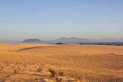 Slope hill sand on yellow dunes on blue sky background. Sunrise, morning. Sustainable ecosystem. Canary island Royalty Free Stock Images