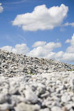 Slope with limestone.JH. Slope with limestone whit a cloudy sky in the background.JH stock images