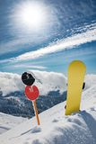 Slope number signs and snowboard at mountains royalty free stock photo