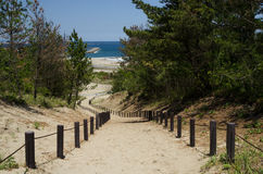 Slope path to the beach. In sunny day stock photos