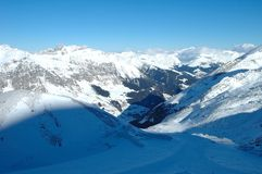 Slope, Peaks and valley in Alps in winter Stock Image