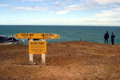 Slope Point New Zealand. Two girls standing at the Southern most point of the south island 0f new zealand stock photos