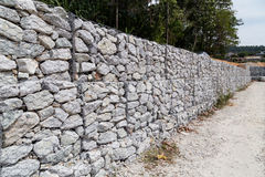 Slope retention management with rocks and wire mesh cage system Stock Photography