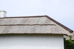 The slope of the roof of reeds and straw. Ancient building materials Royalty Free Stock Photos