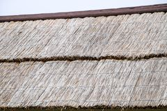 The slope of the roof of reeds and straw. Ancient building materials Royalty Free Stock Photo