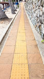 Slope up path of brick walk way decorate with stone wall Stock Images