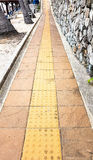 Slope up path of brick walk way decorate with stone wall Royalty Free Stock Photography