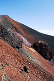 Slope of volcano. With red voulcanic rock soil Stock Photography