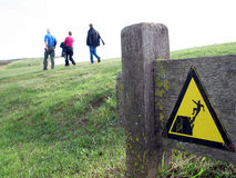 Slope warning sign. A slope warning sign found in Eastbourne near Brighton in Britain. There are some overhanging ledges called The Seven Sisters Royalty Free Stock Image