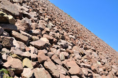 Slope of water dam made in stone Royalty Free Stock Photography