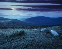 Slope with white boulders in mountains at night Royalty Free Stock Images