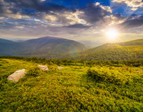 Slope with white boulders in mountains at sunset Stock Photography