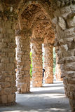 Sloped columns at the Guell Park, Barcelona, Spain. Sloped columns and covered walkway at the Guell Park, Barcelona, Spain which are the load bearing supports Stock Photo