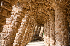 Sloped columns at the Guell Park, Barcelona, Spain. Sloped columns and covered walkway at the Guell Park, Barcelona, Spain which are the load bearing supports Stock Photography