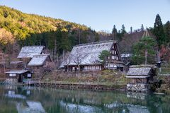 The sloped-roof and thatched-roof houses of snow cover and started to melt at Hida Folk Village. Japan stock photos