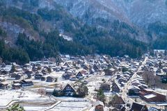 The sloped-roof and thatched-roof houses of snow cover and started to melt at Shirakawa-go. Japan royalty free stock photography
