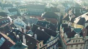 Sloped roofs and narrow streets of famous Old town in Prague, Czech Republic. 4K pan establishing shot stock video footage
