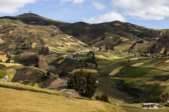 Slopes of colorful crops and homes near Zumbahua. Crops on slopes and farms around Zumbahua province of Cotopaxi, Ecuador Stock Images