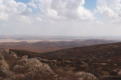 Slopes of Hebron mountain with Negev desert. Southern slopes of Hebron mountain with Negev desert at the horizon in cloudy day Royalty Free Stock Photos