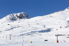 Slopes and lifts at ski resort in Italy, Alps Royalty Free Stock Image