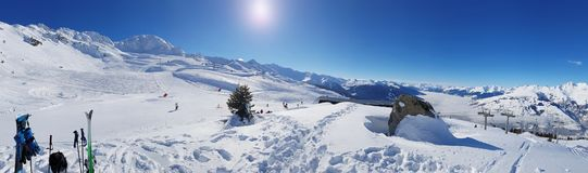 Slopes in mountain panorama. Ski slopes in mountain panorama under blue sky in winter Stock Images