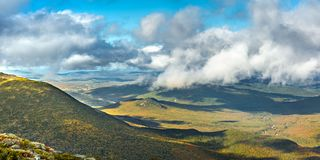 The slopes of Mt Adams viewed from Mount Washington road,. On a sunny fall afternoon, in New Hampshire. A thick layers of clouds covers the valley above the stock photo