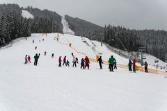Skiers at the slopes of the winter ski resort Ukraine royalty free stock image
